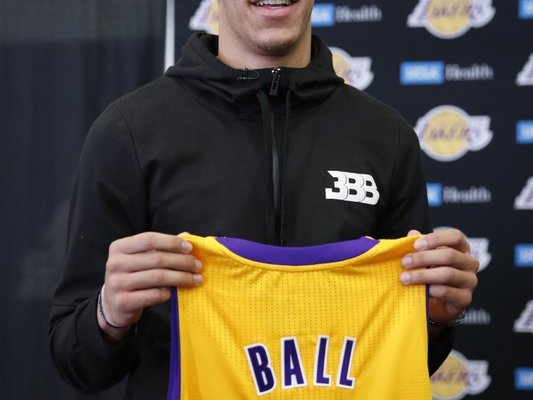 Lonzo Ball holding a Los Angeles Lakers jersey
